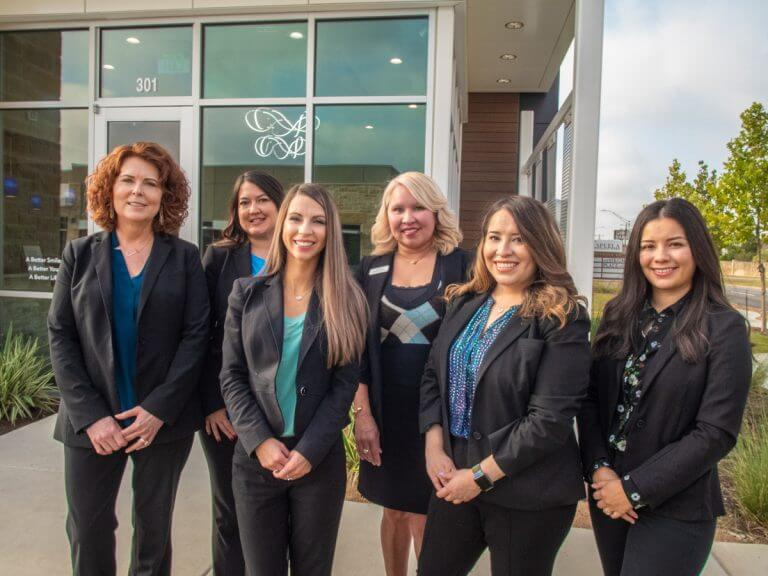 Dental team standing outside Cosmetic Dentistry of San Antonio