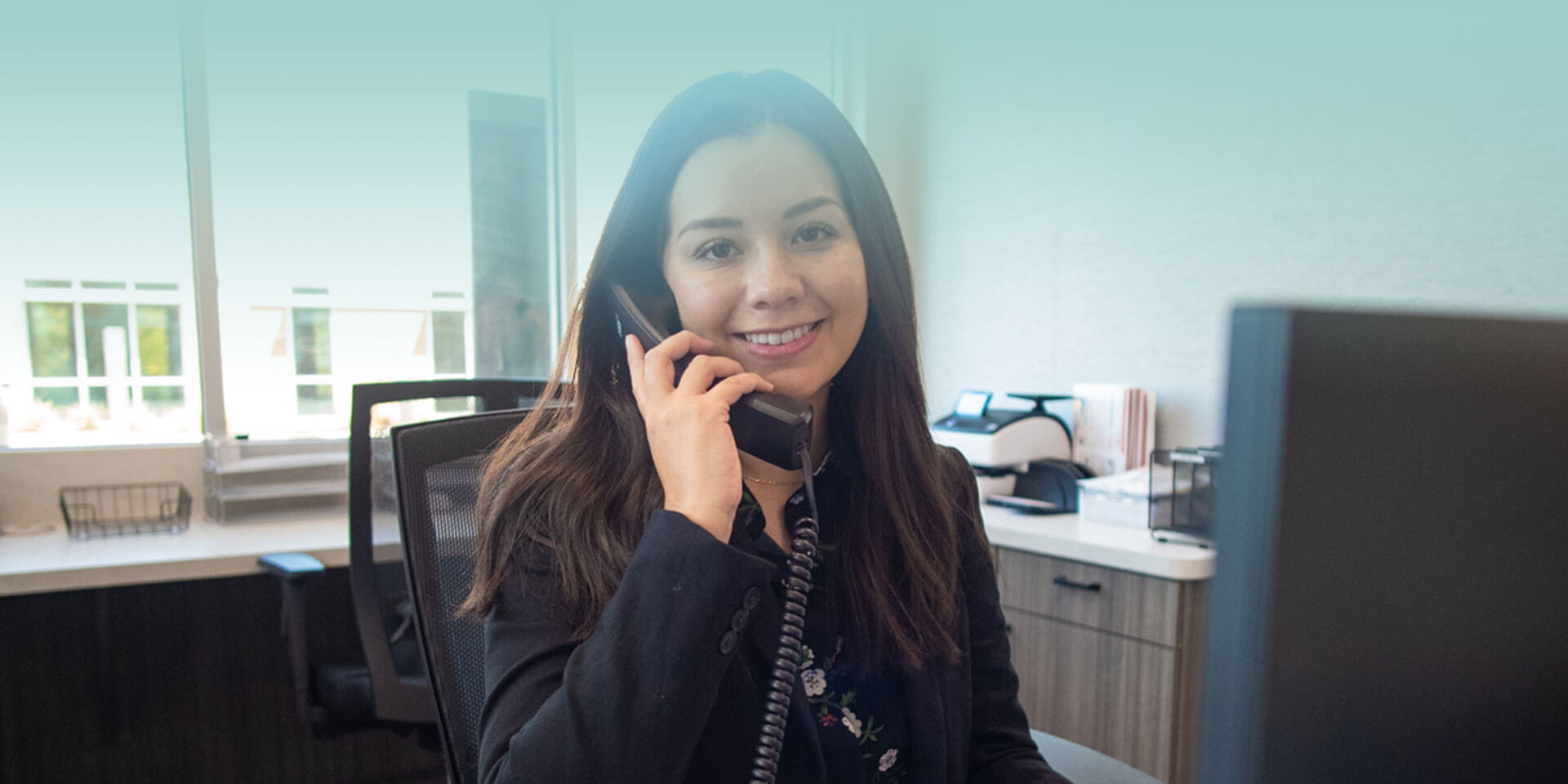 Staff member at Cosmetic Dentistry of San Antonio answering a phone call