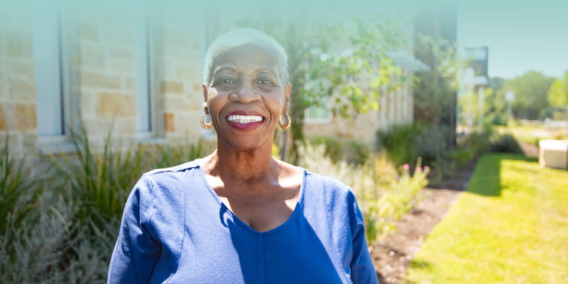 Elderly woman smiling showing white teeth