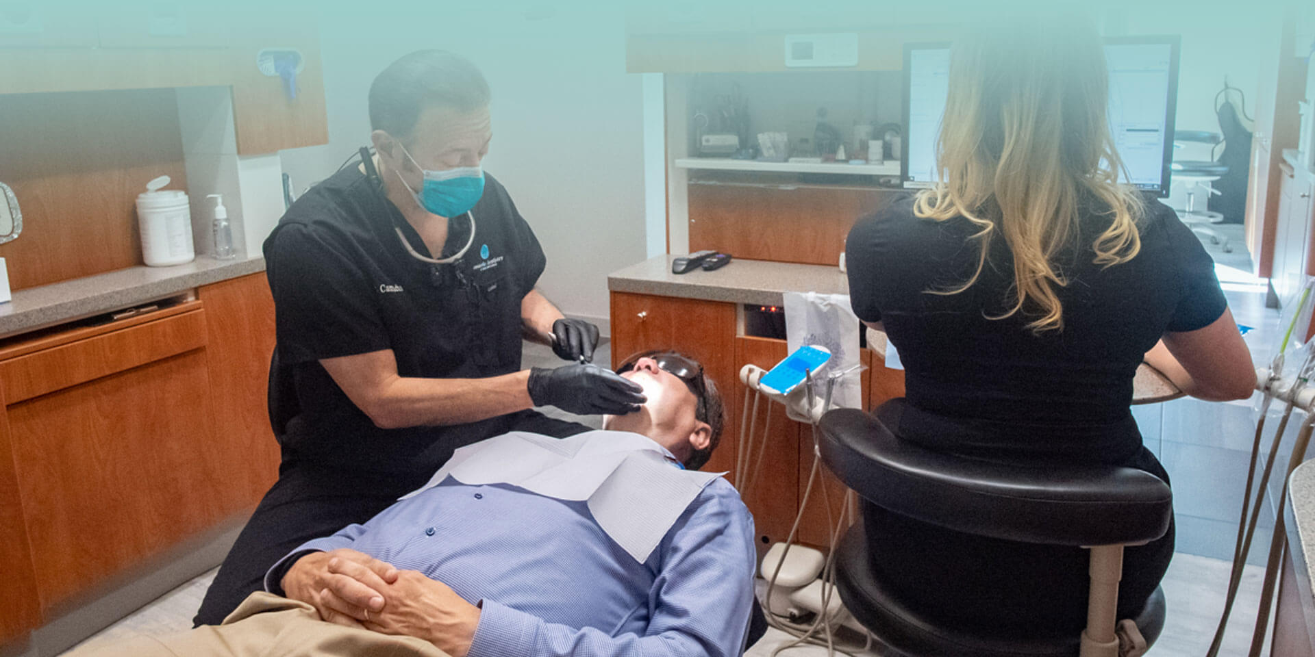 Dr. Edward Camacho performing dental process to a patient