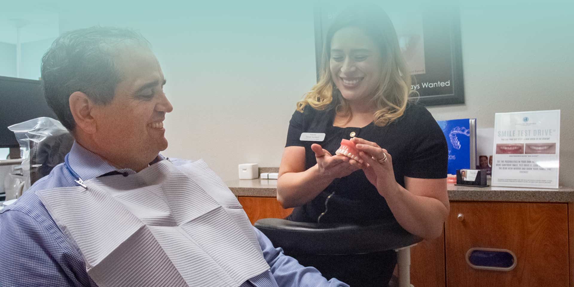 A patient at Cosmetic Dentistry of San Antonio smiling with dental assistant