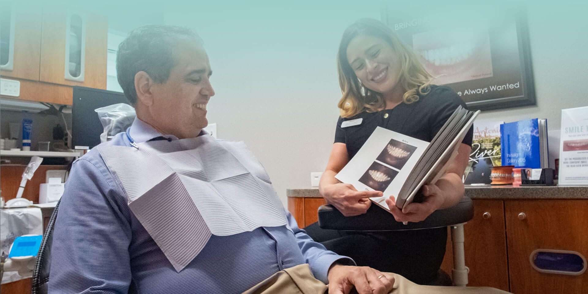 Dental assistant explaining dental process with help of visual images to a patient