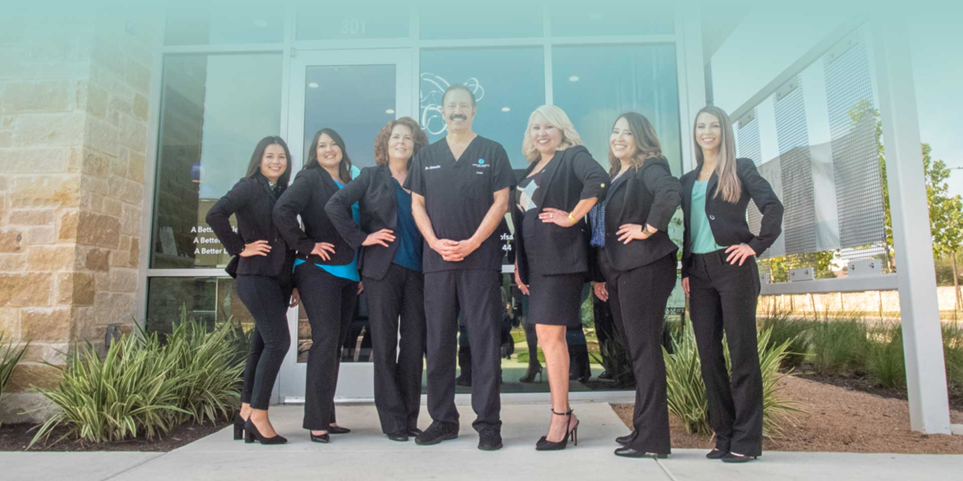 The dental team at Cosmetic Dentistry of San Antonio standing in front of their office