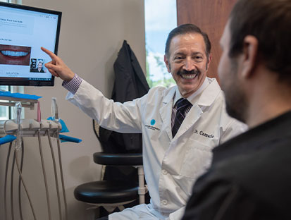 Dr. Camacho with one of his happy patient - image 1