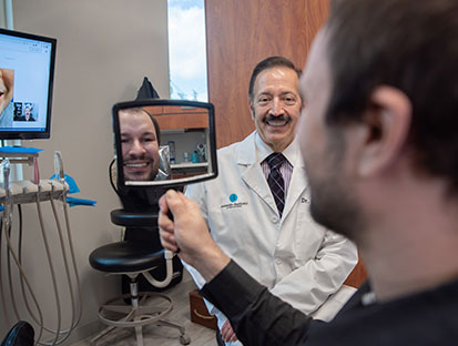 Dr. Camacho with one of his happy patient - image 3